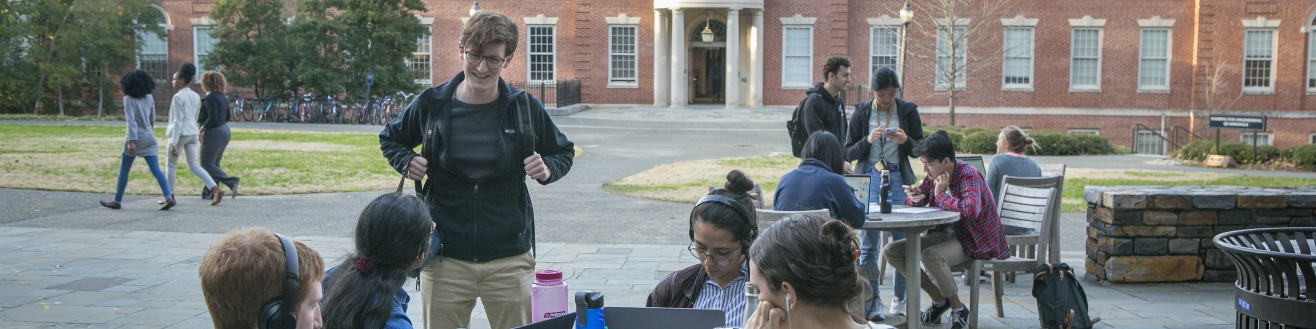 students study outside Hudson Hall on Duke campus